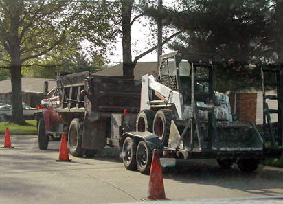 Bebb Asphalt - Dump Truck with Bobcat on Trailer